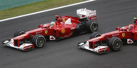 Ferrari Formula One driver Fernando Alonso of Spain (L) drives ahead of team mate Felipe Massa of Brazil during the Brazilian F1 Grand Prix