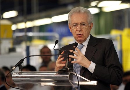 Italy's Prime Minister Mario Monti (C) gestures as he makes his speech during a visit to the Fiat car factory in the southern city of Melfi