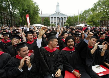 Harvard Business School students cheer during their graduation ceremonies in Boston, Massachusetts, in this June 4, 2009 file picture. Since