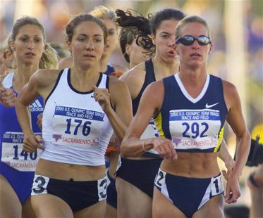 Suzy Favor-Hamilton (292) races next to Mary Cobb (176) and Karen Candaele (140) on her way to winning her heat in the women's 1500m race at