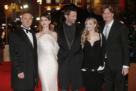 Actors Russell Crowe, Anne Hathaway, Hugh Jackman, Amanda Seyfried and director Tom Hooper (L-R) pose for photographers as they arrive for t