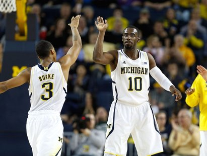 Trey Burke and Tim Hardaway Jr. celebrate after defeating Eastern Michigan 93-54 Thursday night.