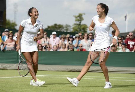Heather Watson of Britain (L) and her partner Laura Robson of Britain laugh during their women's doubles tennis match against Hsieh Su-Wei o