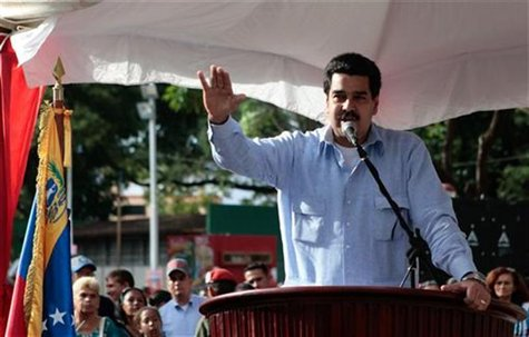 Venezuelan vice president Nicolas Maduro reads a statement about President Hugo Chavez's health condition in Guarico, in this Miraflores Pal