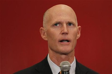 Republican Florida Governor Rick Scott speaks at a meeting of the Latin Builders Association in Miami, Florida January 27, 2012. REUTERS/Joe