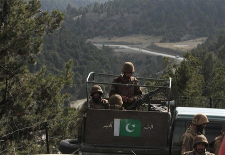 Pakistan army soldiers sit in a vehicle during their patrol at an army outpost in Kharang, about 40 km (21 miles) from Wana November 28, 201