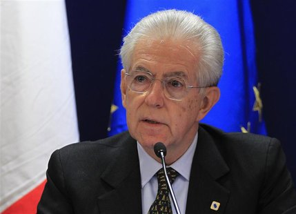 Italy's Prime Minister Mario Monti arrives at a news conference after a European Union leaders summit in Brussels December 14, 2012. REUTERS