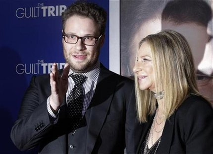 "Barbra Streisand and Seth Rogen, stars of the new film ""The Guilt Trip"" pose as they arrive at the film's premiere in Los Angeles December 1"