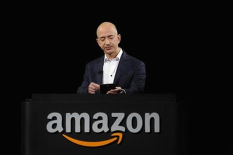 Amazon CEO Jeff Bezos demonstrates the Kindle Paperwhite during Amazon's Kindle Fire event in Santa Monica, California September 6, 2012. RE
