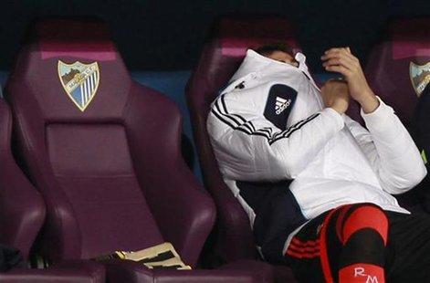 Real Madrid's goalkeeper Iker Casillas sits in the bench during their Spanish First Division soccer match against Malaga at La Rosaleda stad