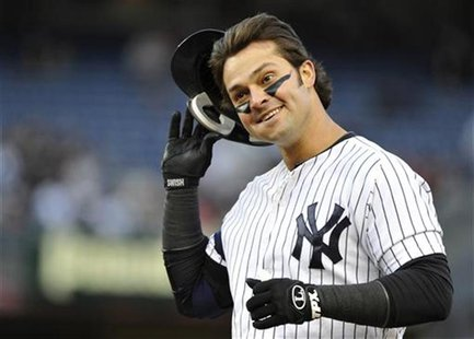 New York Yankees' Nick Swisher reacts after grounding out against the Baltimore Orioles during the second inning in Game 5 of their MLB ALDS