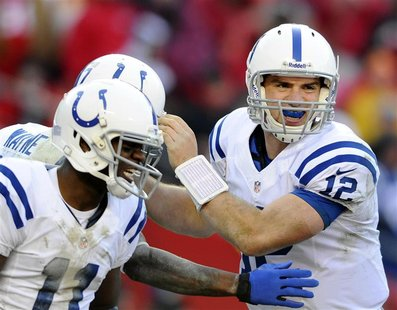 Indianapolis Colts quarterback Andrew Luck (R) and wide receiver Donnie Avery (L) congratulate wide receiver Reggie Wayne on his go-ahead to