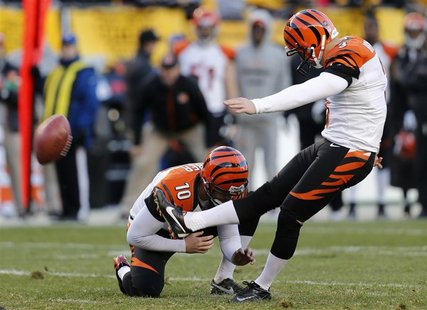 Cincinnati Bengals kicker Josh Brown (3) kicks the game-winning field goal against the Pittsburgh Steelers as Kevin Huber (10) holds in the