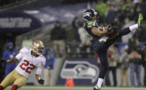 Seattle Seahawks wide receiver Doug Baldwin (R) pulls in a 43-yard pass catch from quarterback Russell Wilson during the first quarter of th