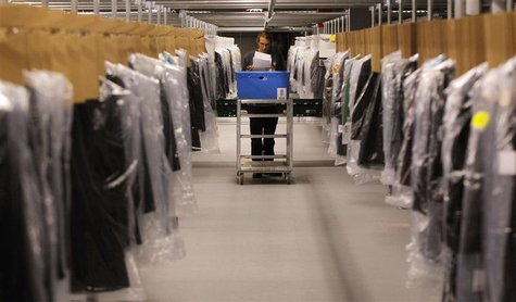 Associate Joseph Rodeheaver fills clothing orders at the Macy's-Bloomingdale's fulfillment center in Martinsburg, West Virginia in this Dece
