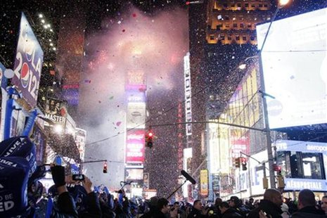 Revellers usher in the new year at midnight during New Year's Eve celebrations at Times Square in New York, January 1, 2012. REUTERS/Kena Be