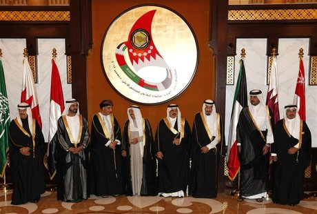 Dignitaries pose for a group photo prior to the start of the Gulf Cooperation Council (GCC) Summit at Sakhir Palace in Sakhir south of Manam