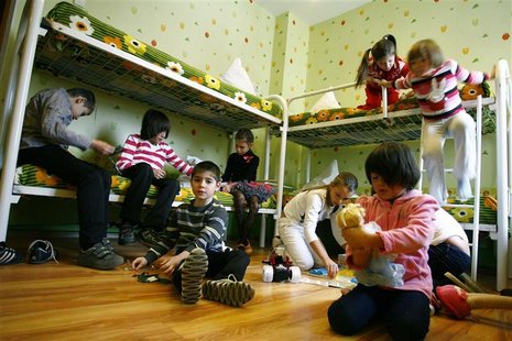 Orphan children play in their bedroom at an orphanage in the southern Russian city of Rostov-on-Don, December 19, 2012. REUTERS/Vladimir Kon