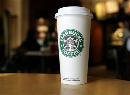 A cup displaying the Starbucks Coffee logo is pictured at one of the coffee chain's store in Boca Raton, Florida January 19, 2010. REUTERS/J