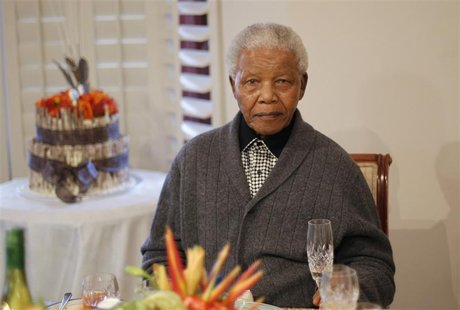 Former South African president Nelson Mandela looks on as he celebrates his birthday at his house in Qunu, Eastern Cape July 18, 2012. REUTE