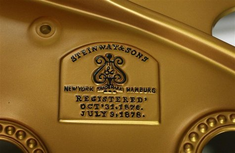 The emblem of a historic Concert Grand piano build on May 11, 1892, is pictured during its refurbishing at the Steinway & Sons factory in Ha