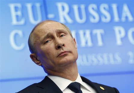 Russian President Vladimir Putin looks on during a joint news conference with European Council President Herman Van Rompuy and European Comm