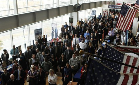 Job applicants listen to a presentation prior to the opening of a job fair for veterans and their spouses held by the U.S. Chamber of Commer