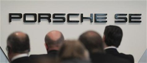 Journalists attend the annual news conference of the Porsche Automobil Holding SE in Stuttgart March 15, 2012. REUTERS/Alex Domanski