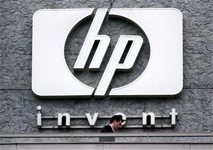 A man walks past the Hewlett Packard logo at its French headquarters in Issy le Moulineaux, western Paris, in this September 16, 2005 file p