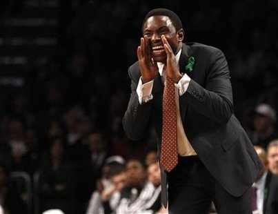 Brooklyn Nets head coach Avery Johnson shouts instructions to his players in the second quarter of their NBA basketball game against the Bos