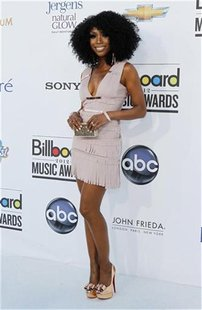 Recording artist Brandy Norwood poses on the red carpet as she arrives at the 2012 Billboard Music Awards in Las Vegas, Nevada May 20, 2012.