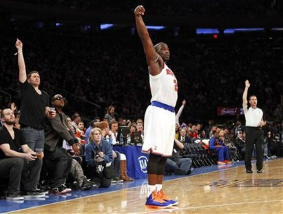 New York Knicks point guard Raymond Felton watches a three-point shot against the Cleveland Cavaliers in the third quarter of their NBA bask