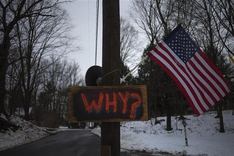 A sign is posted on an electricity pole outside a house near Sandy Hook Elementary School, nearly two weeks after a gunman shot dead 20 stud