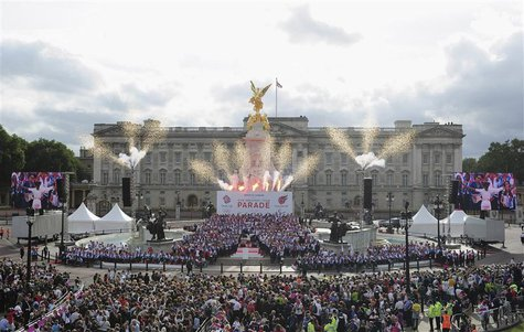 Athletes stand together on the Queen Victoria Memorial during a parade of British Olympic and Paralympic athletes in front of Buckingham Pal