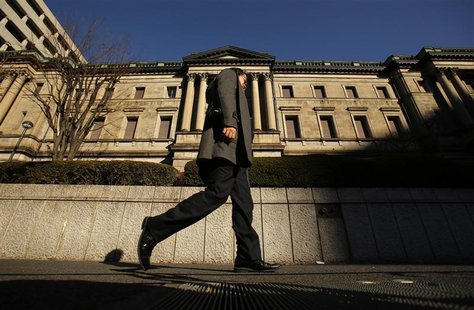 A man walks past the Bank of Japan headquarters in Tokyo December 19, 2012. REUTERS/Yuriko Nakao
