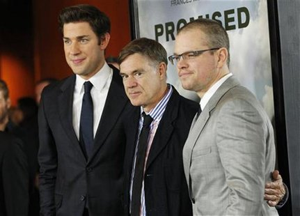 "Director Gus Van Sant (C) poses with cast members Matt Damon (R) and John Krasinski at the premiere of ""Promised Land"" at the Directors Guil"