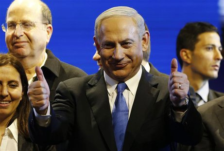 Israel's Prime Minister Benjamin Netanyahu (C) is seen during the launch of his Likud Beiteinu party campaign ahead of the upcoming January