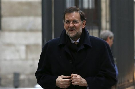 Spain's Prime Minister Mariano Rajoy arrives at parliamentary session for the formal approbation of the budget for 2013 at Parliament in Mad
