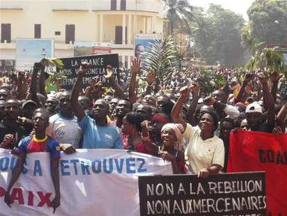 Supporters of Central African Republic President Francois Bozize and anti-rebel protesters chant slogans as they gather for an appeal for he