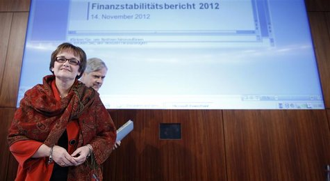 Bundesbank Vice President Sabine Lautenschlaeger (L) and board member of Bundesbank Andreas Dombret arrive for a news conference in Frankfur