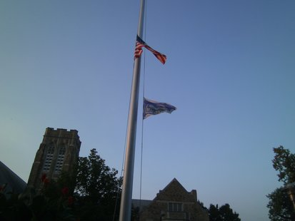 US and Wisconsin Flags at half-staff.
