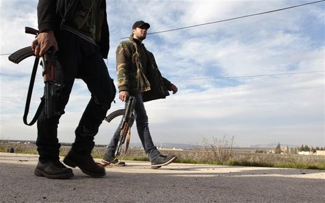 Free Syrian Army fighters walk as they seize Menagh military airport in north Aleppo December 28, 2012. REUTERS/Ahmed Jadallah