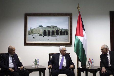 Palestinian President Mahmoud Abbas meets with Arab League Secretary-General Nabil Elaraby (L) and Egyptian Foreign Minister Mohamed Kamel A
