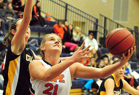 Hope forward Courtney Kust (21) goes up for a shot.