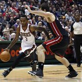 Milwaukee Bucks guard Brandon Jennings (L) drives to the basket against Miami Heat center Josh Harrellson in the second half of their NBA ba