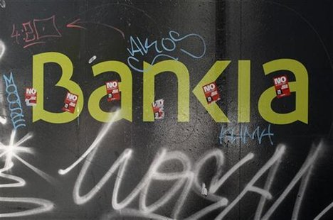 The logo of the Bankia bank is seen on a wall in Madrid May 25, 2012. REUTERS/Andrea Comas