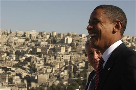US Democratic presidential candidate Senator Barack Obama (D-IL) (R) shares a laugh with Senator Chuck Hagel (R-NE) at the Amman Citadel in