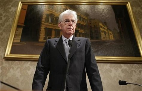 Italy's outgoing Prime Minister Mario Monti looks on during a news conference in Rome December 28, 2012. Monti said on Friday that he would