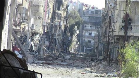 A view of buildings damaged by what activists said were missiles fired by a Syrian Air Force fighter jet loyal to President Bashar al-Assad