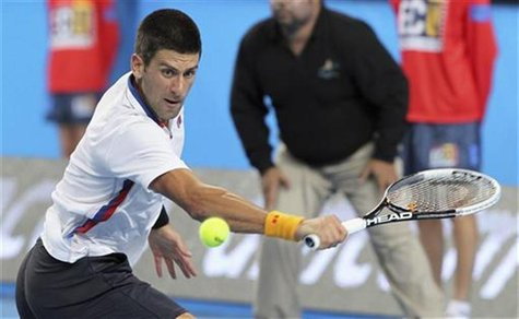 Novak Djokovic of Serbia hits a return to Andreas Seppi of Italy during their men's singles match at the Hopman Cup tennis tournament in Per